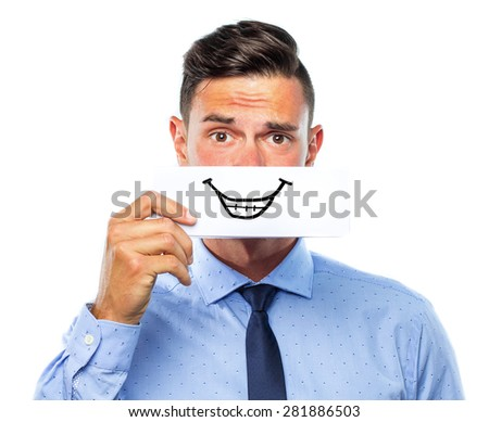 Young business man holding a card with a drawing smile  - stock photo