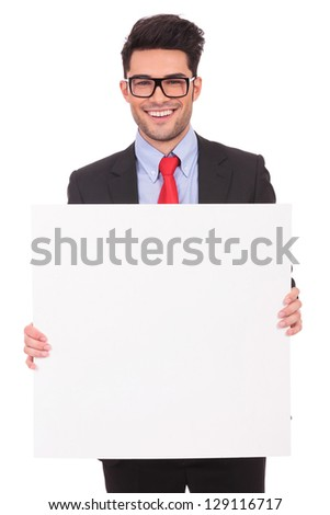 young business man holding a plank with both hands while smiling to the camera on a white background - stock photo