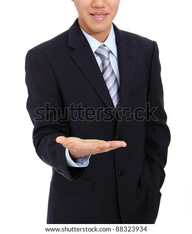 young business man holding hand presenting a product. isolate on white background - stock photo
