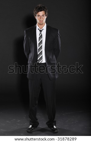 Young Business Man in Black Suit - stock photo