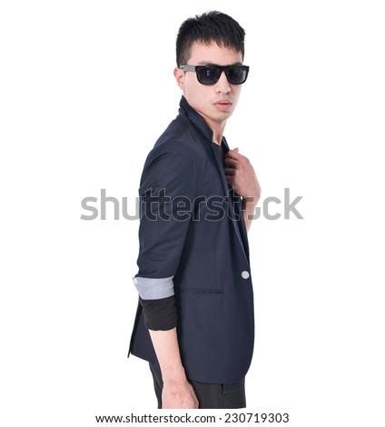 young business man in sunglasses standing  - stock photo