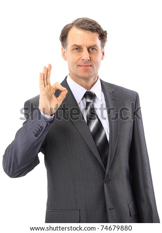 Young business man, in the suit, showing a sign ok - stock photo
