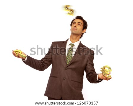 young business man juggling with different currency - stock photo