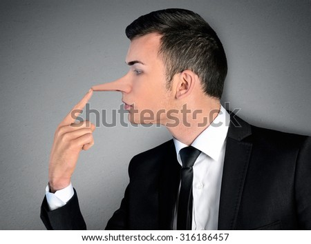 Young business man liar concept - stock photo