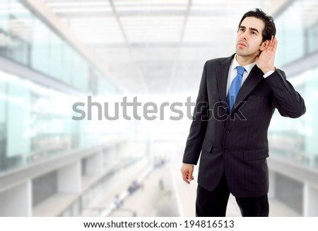 young business man listening at the office - stock photo