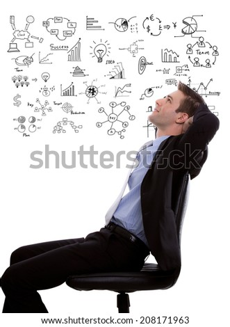 Young business man looking up and planning with business graph - stock photo