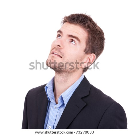 Young business man looking up on white background - stock photo