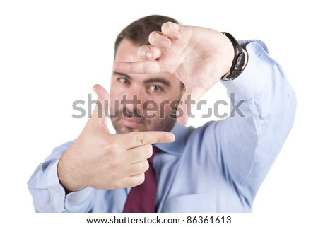 young business man making frame with finger against white background, selective focus on hands - stock photo