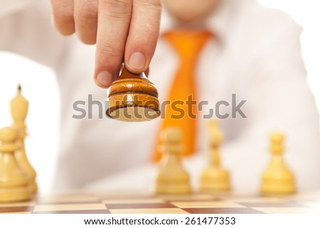 Young business man moving chess figure  - stock photo