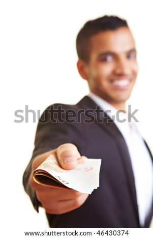 Young business man offering a stack of money - stock photo