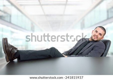 young business man on a desk, at the office - stock photo