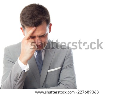 Young business man over white background. Looking sad - stock photo