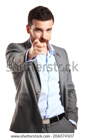 young business man pointing to the camera on white background  - stock photo
