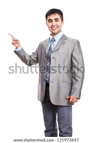 Young business man pointing to white background - stock photo