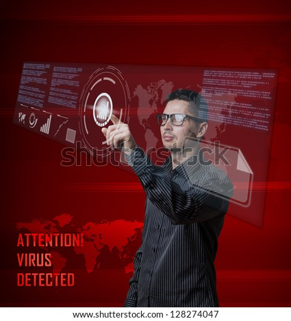 Young business man pushing digital button on interface - stock photo
