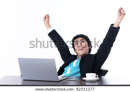Young business man relax with happily after working - stock photo