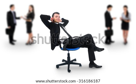 Young business man relaxing at office - stock photo