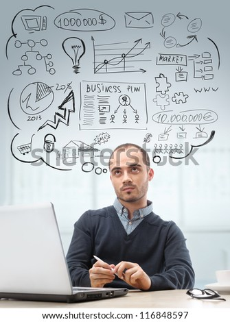 Young business man sitting at office looking up and planning. Graphic sketch style thoughts overhead - stock photo