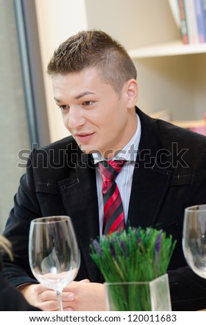 Young business man talking over dinner - stock photo