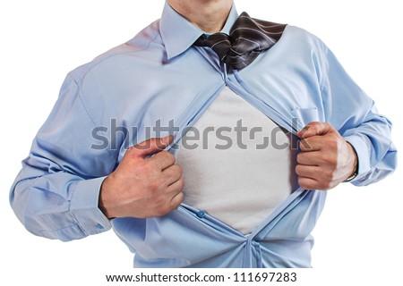 Young business man tearing apart his shirt revealing a superhero suit - stock photo