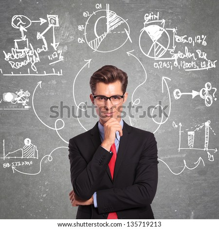 young business man thinking at every aspect of a problem - stock photo