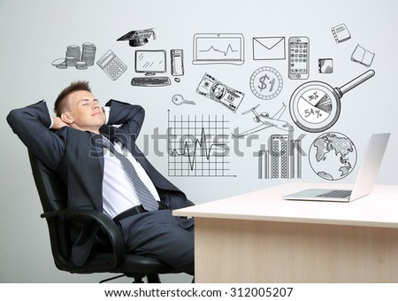 Young business man thinking of him plans - stock photo