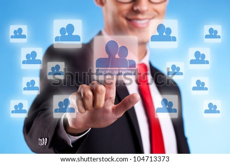 young business man wearing glasses, pressing a digital buttonon a virtual touch screen - stock photo