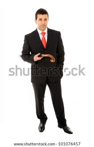young business man with an umbrella against white background - stock photo