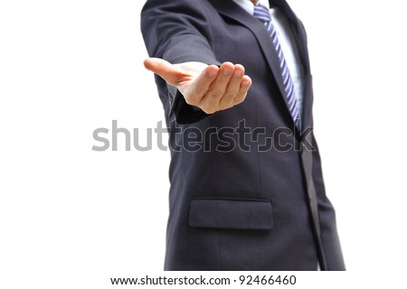 Young business man with concept of giving (holding empty hand) isolated on white - stock photo