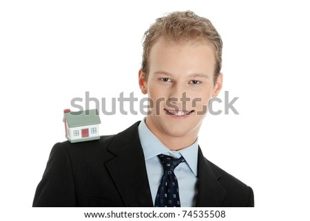 Young business man with house model - real estate concept. Isolated on white - stock photo
