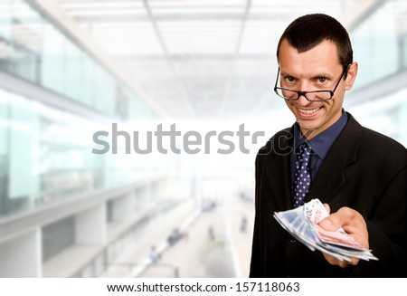 young business man with money at the office - stock photo