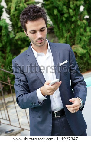young business man with phone - stock photo