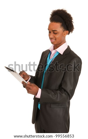 Young business man with tablet PC in studio - stock photo