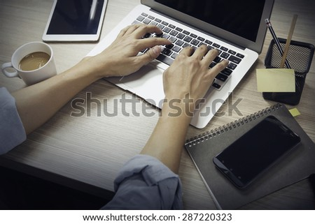 Young Business Man Working Hard, at the office table, time lapse footage - stock photo