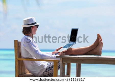 Young business man working in outdoor cafe - stock photo