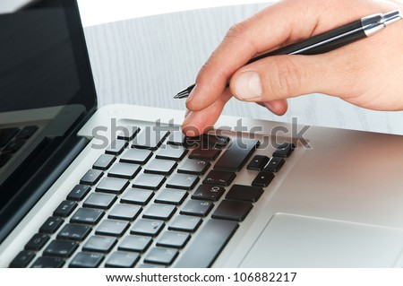 Young business man working on laptop - stock photo
