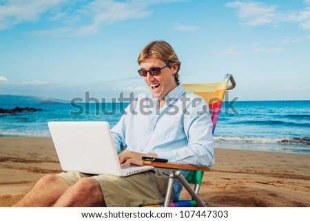 Young Business Man Working Remotely on Tropical Beach - stock photo
