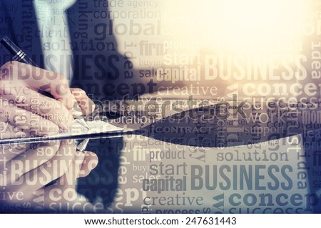 Young business man working with documents - stock photo