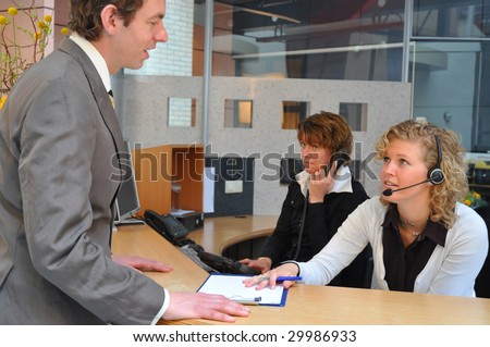 Young business men registering for job interview - stock photo
