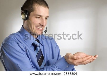 young business men with headset holding hands portrait - stock photo