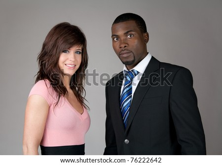 Young business partners, Caucasian woman and African American man. - stock photo