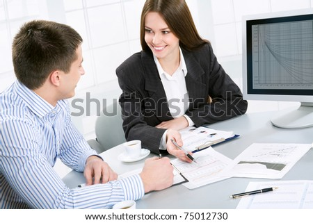 Young business people at the office - stock photo