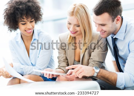 Young business people discussing in office - stock photo