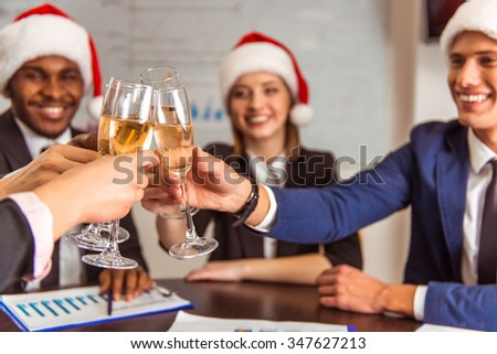 Young business people during the celebration of Christmas in the office - stock photo