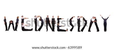 Young business people forming Wednesday word over white - business calendar concept - stock photo