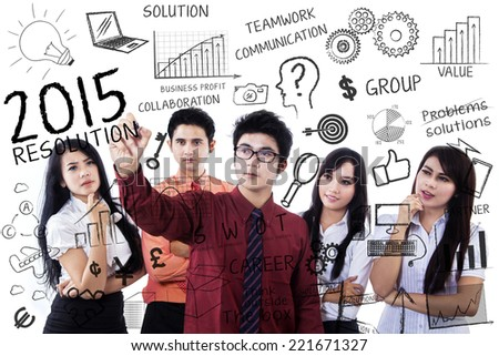 Young business people give idea to their leader and make resolutions in 2015 - stock photo