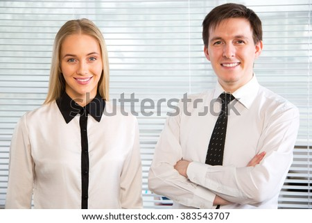 Young business people in an office - stock photo