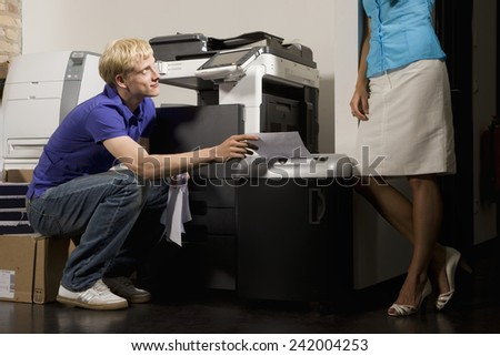 Young Business People in Copy Room - stock photo