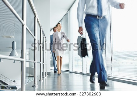 Young business people in formalwear going for work - stock photo