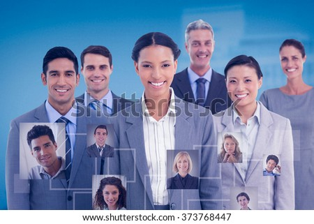 Young business people in office against low angle view of city buildings - stock photo